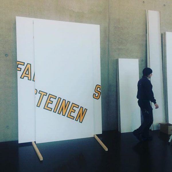 #deconstruction #lawrenceweiner #kunsthausbregenz #sad #writing #letters #stones #steine #wall #segment #white #orange