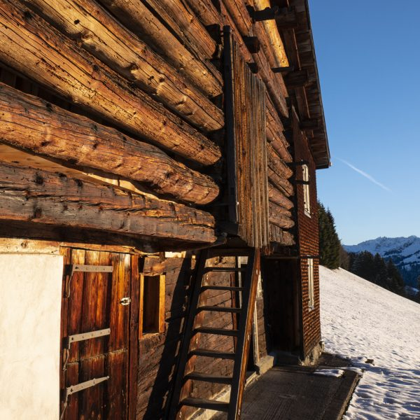 The very early morning sun on another hut in the mountains. A great ...