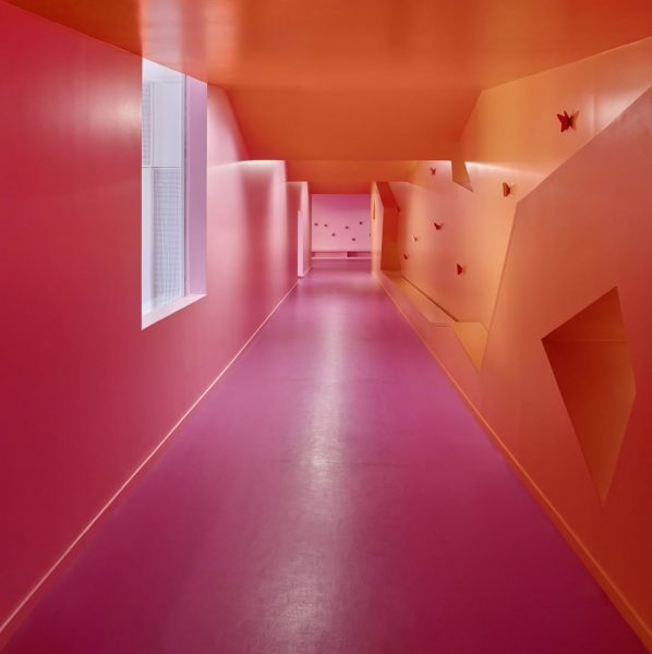 Blocks of contrasting paintwork decorate corridors, playgrounds, and roof-top gardens of the Simone ...