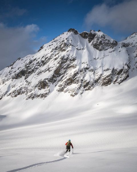 Skiing down onto the Silvretta Glacier after a long day of climbing Piz ...