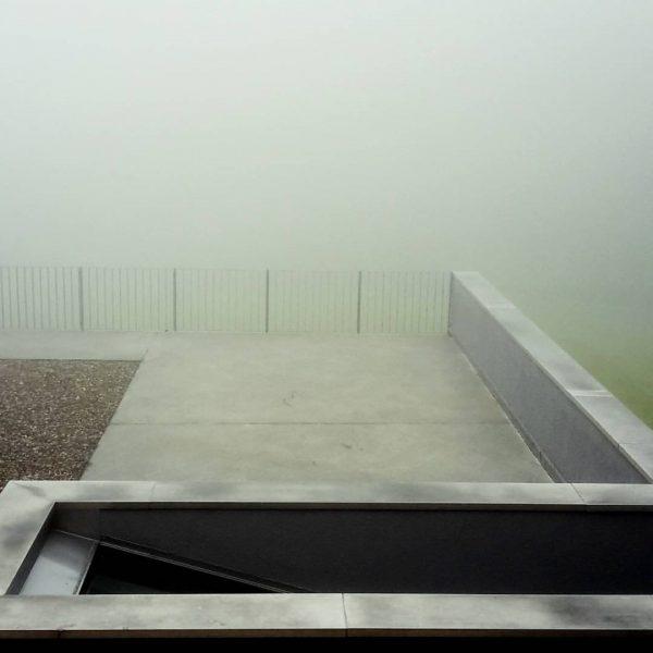 Mist omnipotent... #foggyland #green #mist #inmountains #highland #minimalism #geometry #alps #visitaustria🇦🇹 #warth Hotel ...