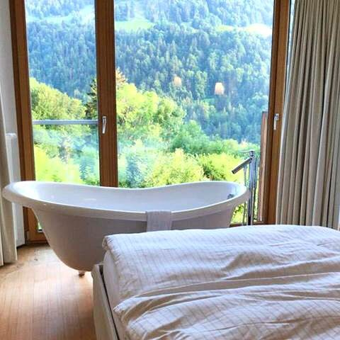 Wow! What an amazing view while having a bath @romantik_hotel_das_schiff 🛁Just the right ...
