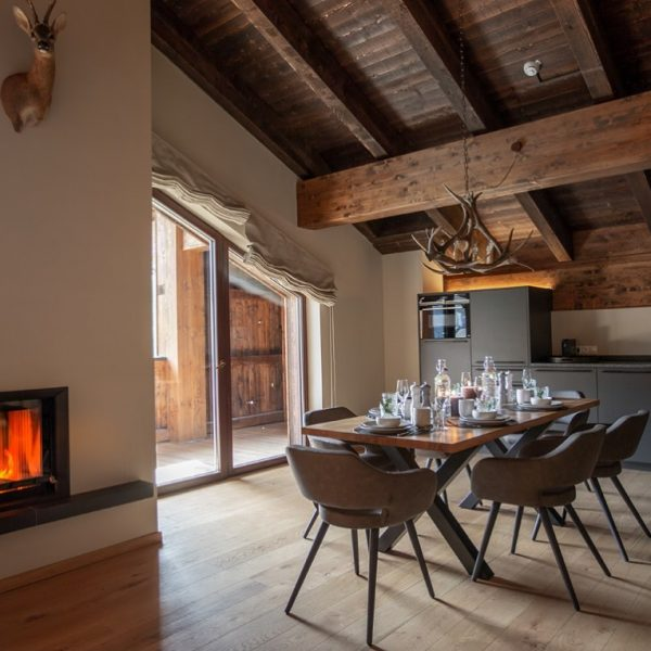 Let's spy in one of our cosy apartments 👀... with a fire place. ...