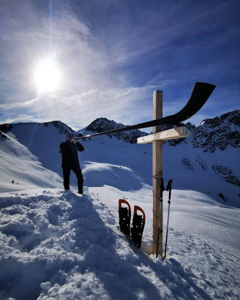 - HORN THE CROSS high above Oberpartnom Alpe, Großes Walsertal Vorarlberg, Austria. In ...