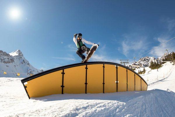 @petergoldberg over the new rainbow rail at @backyards_snowpark. 📸@christianfreyerphoto . . Use #shredunfamiliar ...