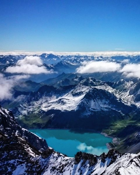Mountains to the horizon: View from Schesaplana (2965m) over beautiful Lünersee, Rätikon July ...