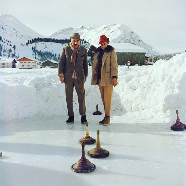 Circa 1961: Heinrich Dite and Leonie Heller play a variety of curling in Lech, Austria — by...