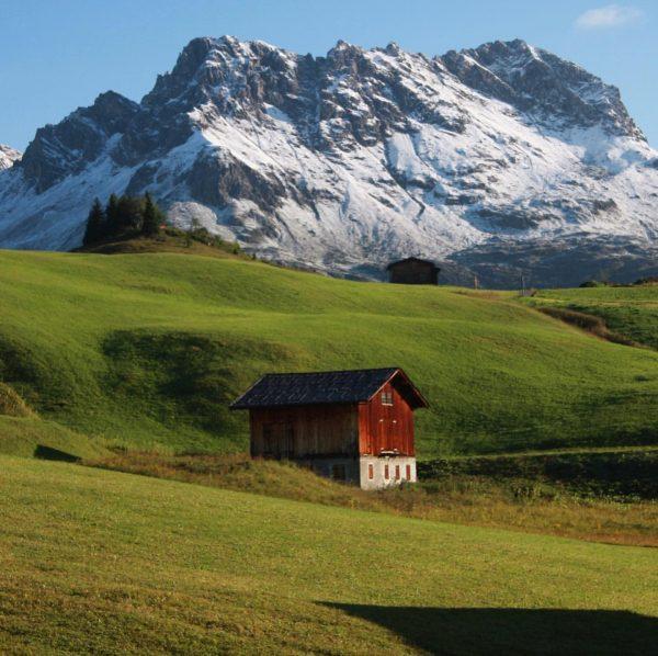 Alpine Landscape #alpinelandscape #alm #oberlech #vorarlberg #snowcappedmountains #meadow #hut #landscape #alps #travel #travelblogger ...