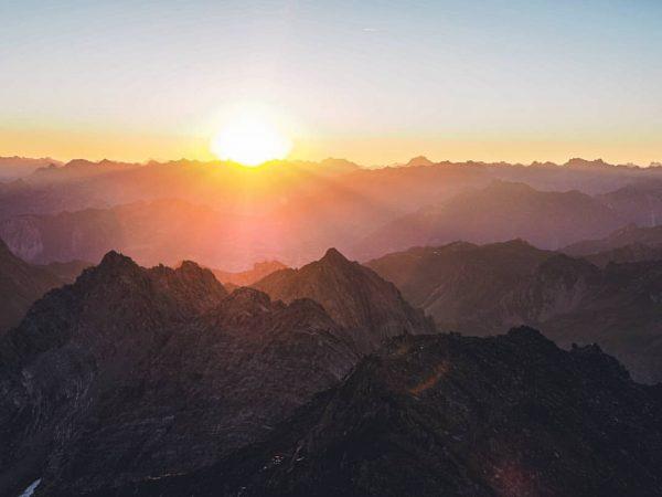 Sunrise from the Schesaplana summit, the highest mountain of the Rätikon mountain range. ...