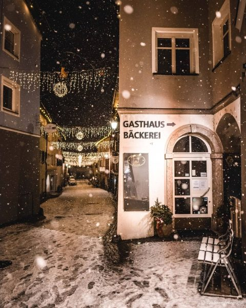 Love the calm and peace of snow falling when the lights are shining ...