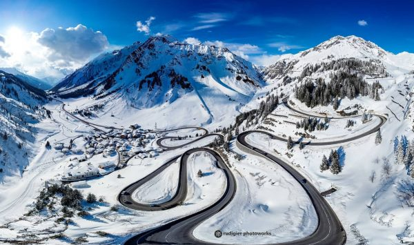 Like a worm, the Arlberg Pass road winds its way up and disappears ...